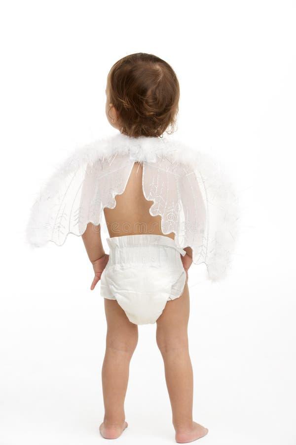 Vista posterior de las alas del panal y del ángel del niño que desgastan imágenes de archivo libres de regalías