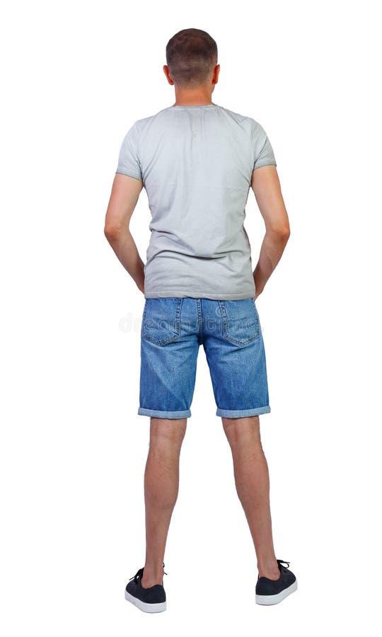 Vista posterior de los pantalones cortos de manín jóvenes imagenes de archivo
