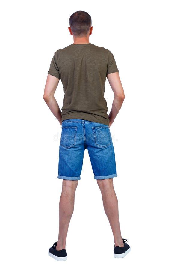 Vista posterior de los pantalones cortos de manín jóvenes fotografía de archivo libre de regalías
