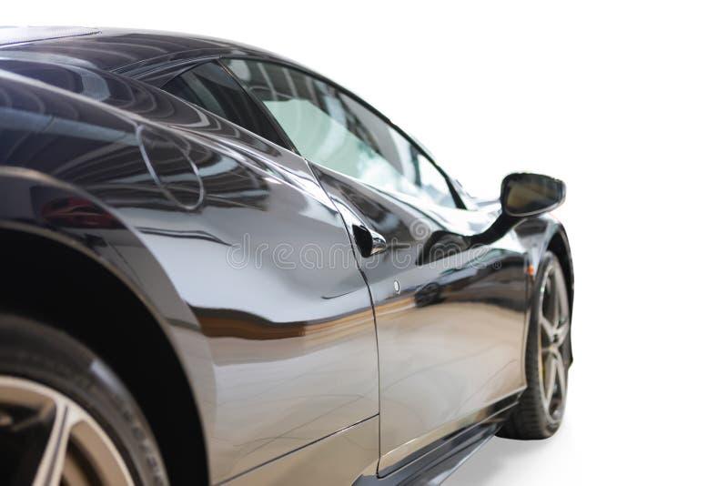Vista posterior del coche de lujo elegante brillante deportivo negro del automóvil foto de archivo libre de regalías
