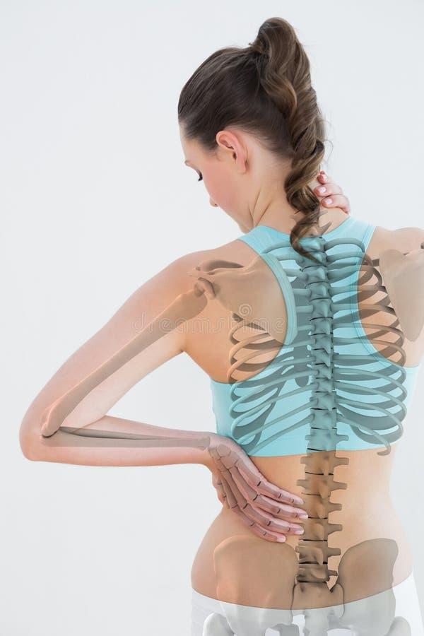 Vista posterior del sufrimiento femenino del dolor muscular fotografía de archivo libre de regalías