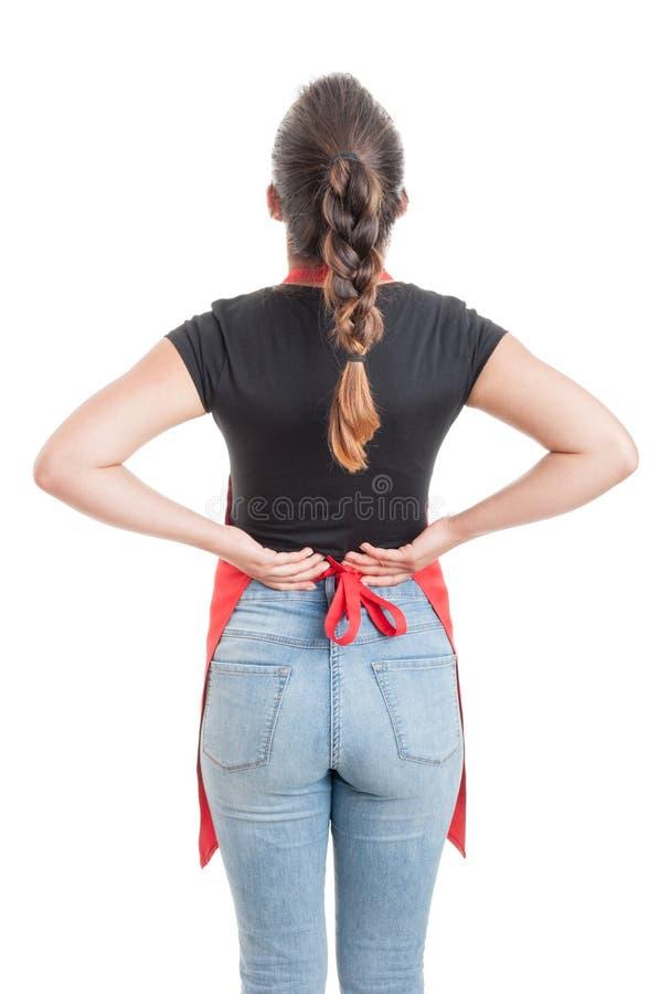 Vista posterior del vendedor que sufre de dolor de espalda foto de archivo libre de regalías