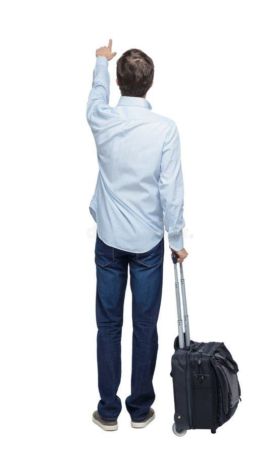 Vista posteriore dell'uomo d'affari con valigia fotografia stock