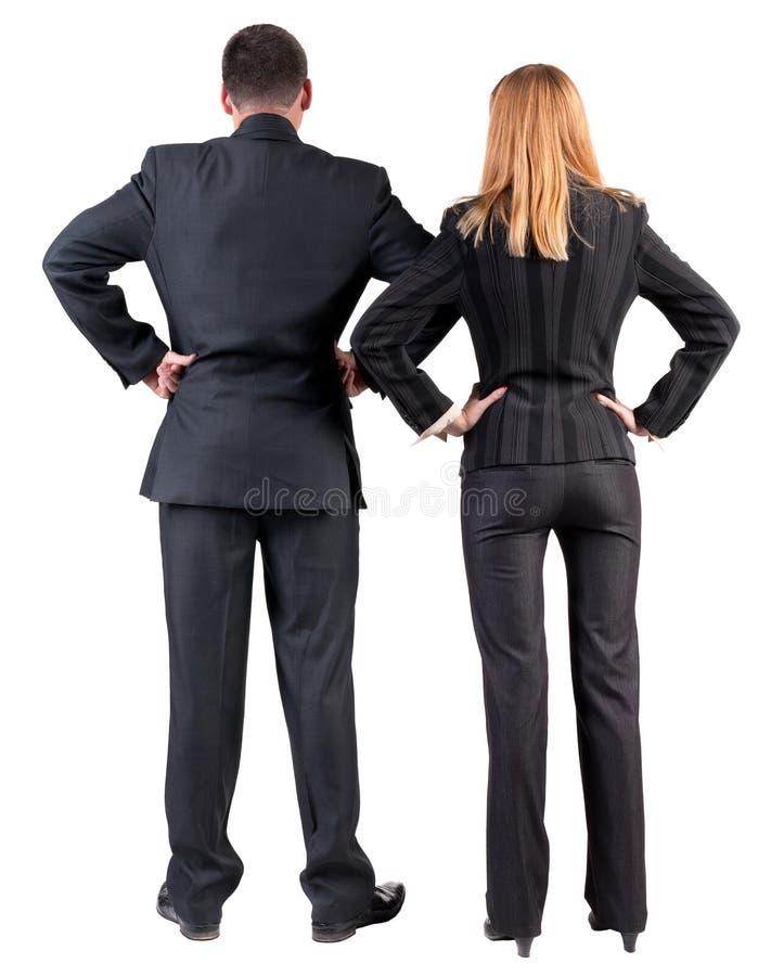 Vista posteriore dello sguardo del gruppo di affari nella distanza immagini stock libere da diritti