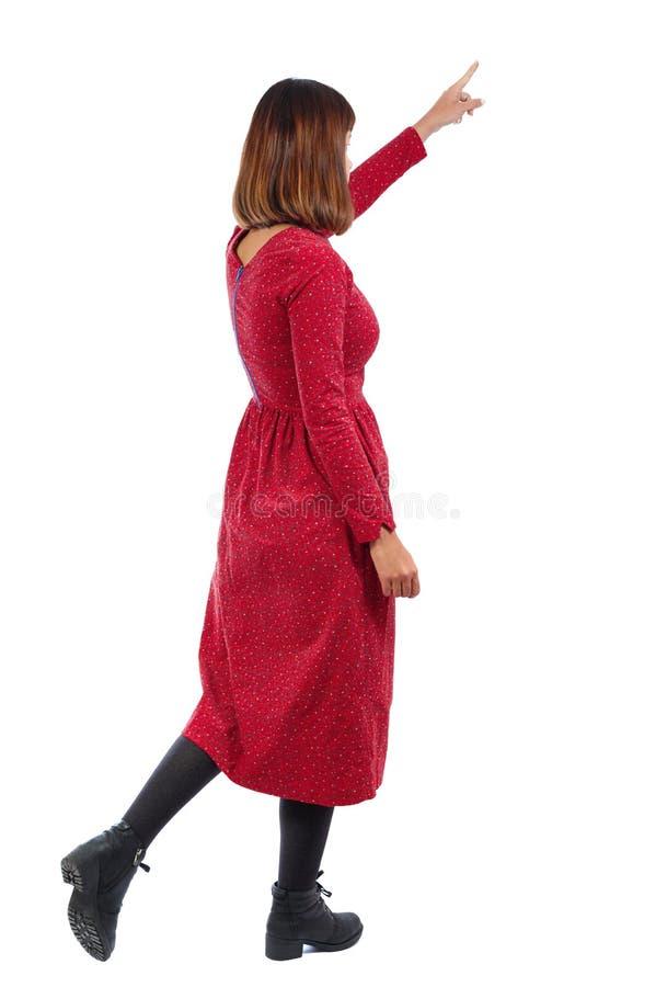 Vista posteriore di indicare donna di camminata fotografia stock