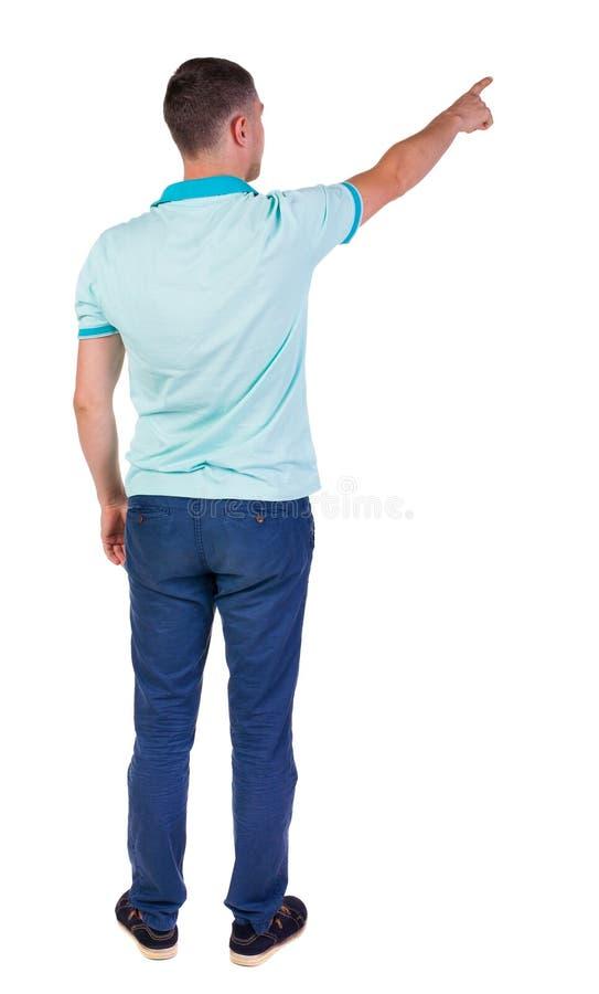 Vista posteriore di indicare i giovani in camicia e jeans fotografia stock