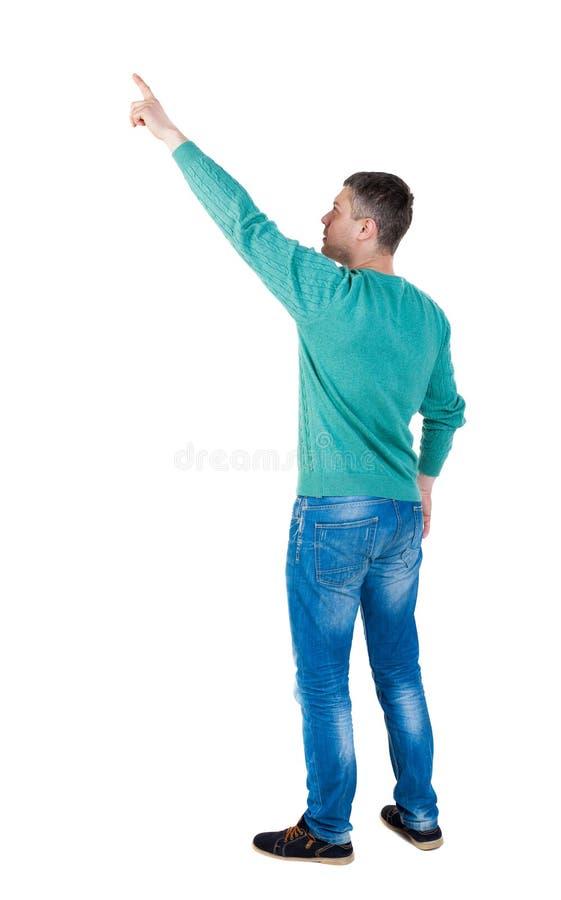 Vista posteriore di indicare i giovani in jeans immagini stock libere da diritti