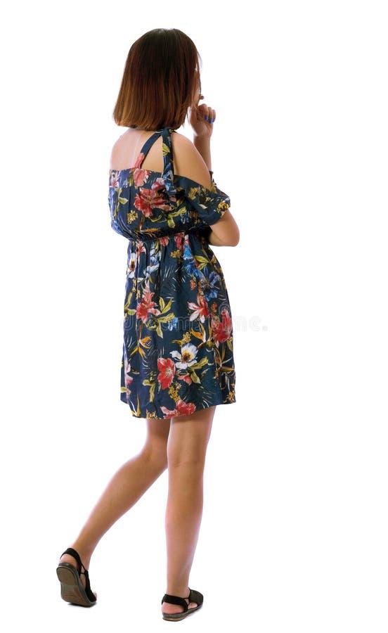 Vista posteriore di stare giovane bella donna fotografie stock libere da diritti