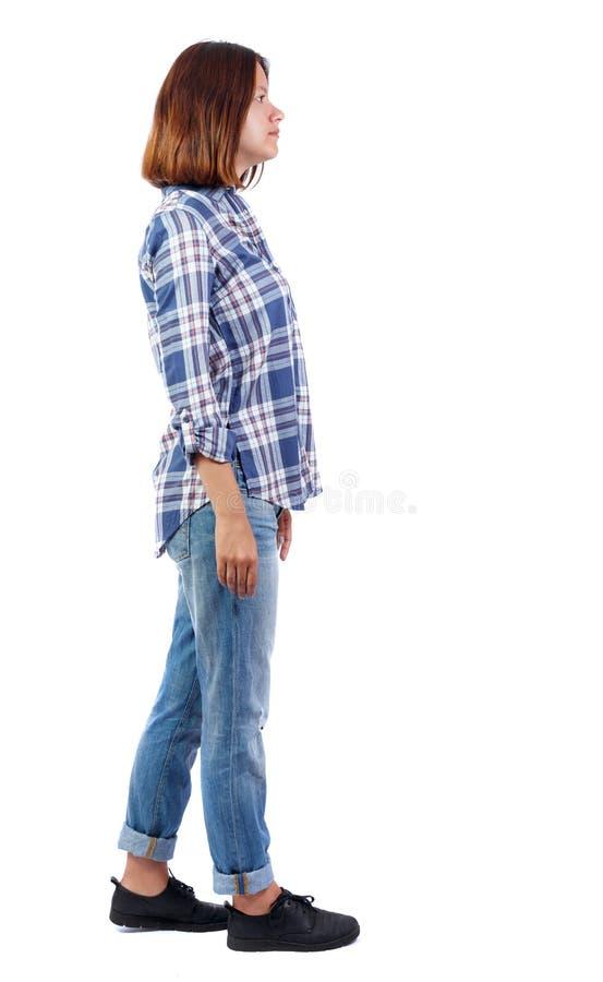 Vista posteriore di stare giovane bella donna fotografia stock libera da diritti