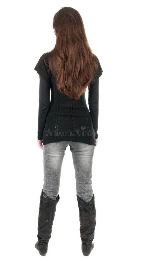 Vista posteriore di stare giovane bella donna. fotografia stock