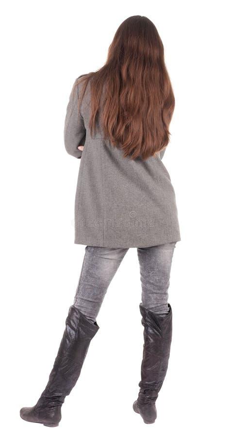 Vista posteriore di stare giovane bella donna. fotografia stock libera da diritti