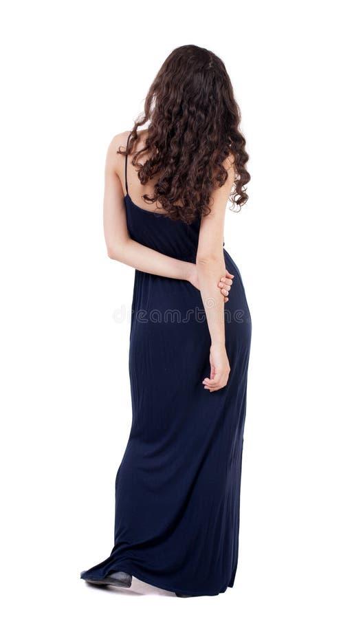 Vista posteriore di stare giovane bella donna immagini stock