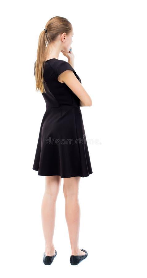 Vista posteriore di stare giovane bella donna immagine stock