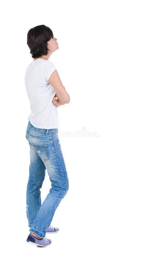 Vista posteriore di stare giovane bella donna castana fotografie stock