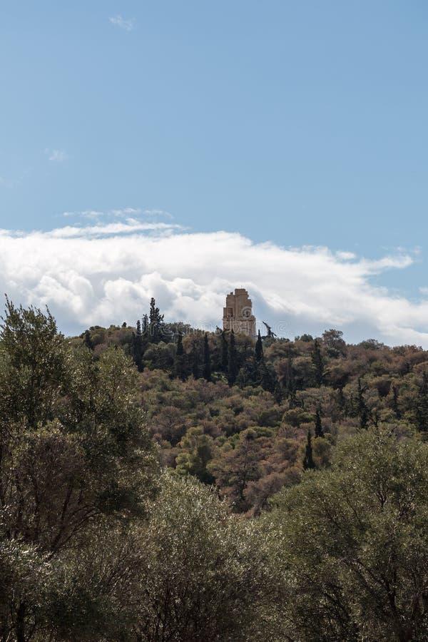 Vista soleggiata della collina Atene, Grecia di Filopappos fotografie stock libere da diritti