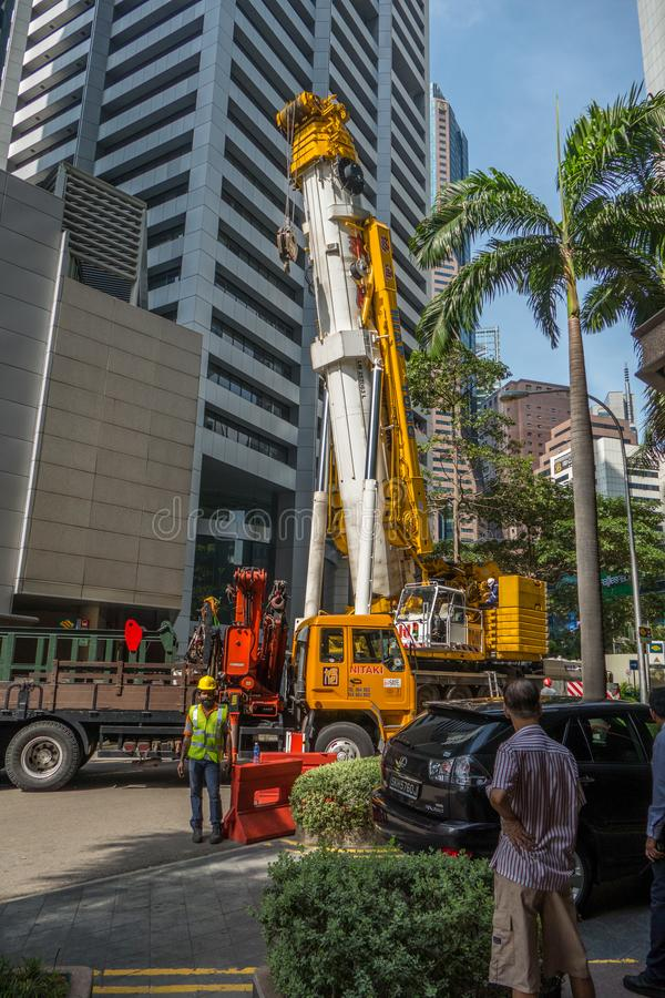 Vista sul cantiere contro della città moderna a Singapore immagine stock libera da diritti