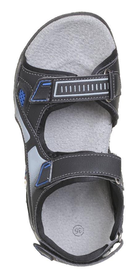Vista superior de la sandalia negra, azul y gris del muchacho imagen de archivo