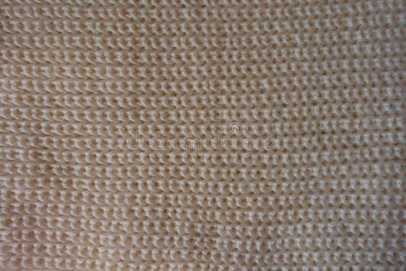 Vista superior de la tela hecha punto beige fotografía de archivo libre de regalías