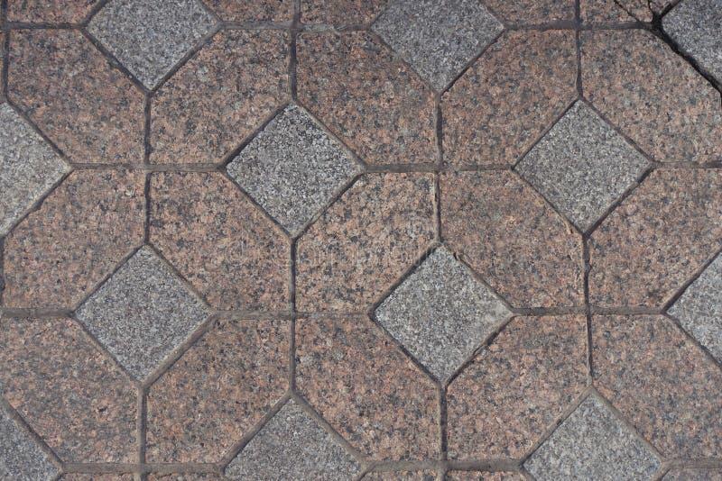 Vista superior de las pavimentadoras sin pulir rosadas y grises del granito foto de archivo libre de regalías