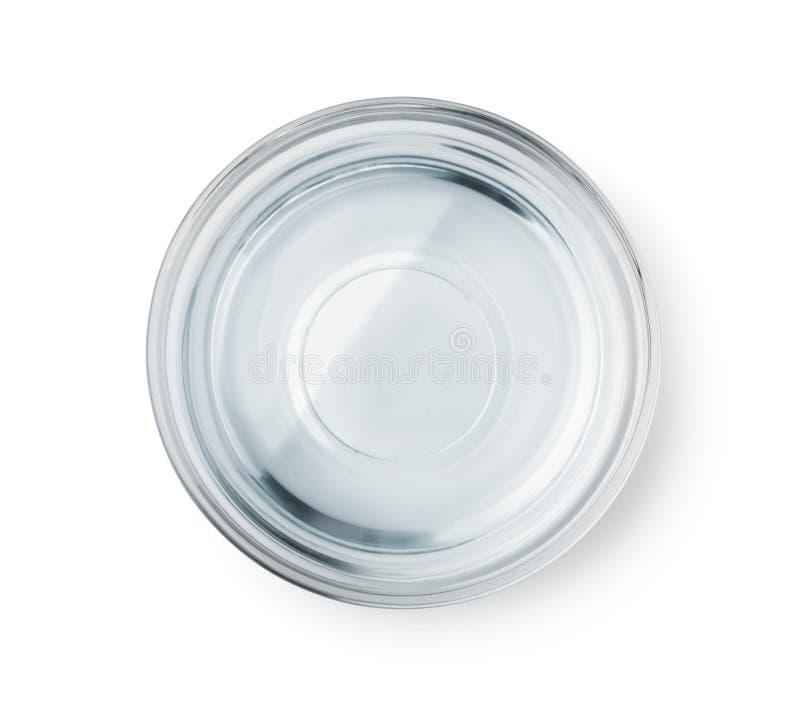 Vista superior del bol de vidrio con agua clara fotos de archivo