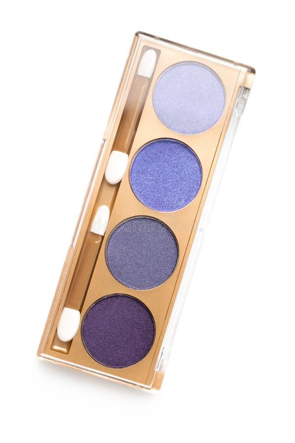 Vista superior del caso con diversas sombras de ojos cosméticas púrpuras sombreadas imagen de archivo libre de regalías