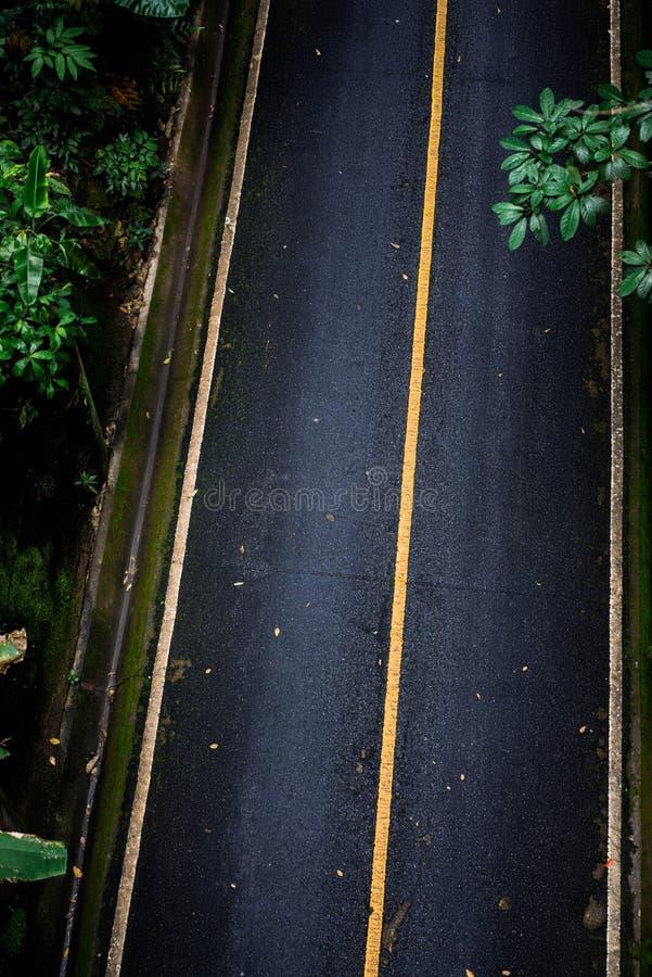 Vista superior del fondo de la textura del asfalto Camino vacío de la visión superior fotografía de archivo