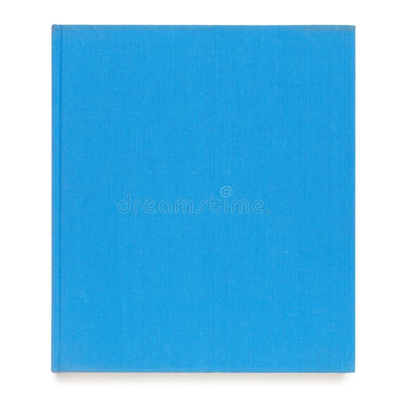 Vista superior del libro de tapa dura en blanco con color del azul de la cubierta de tela Aislado en el fondo blanco foto de archivo