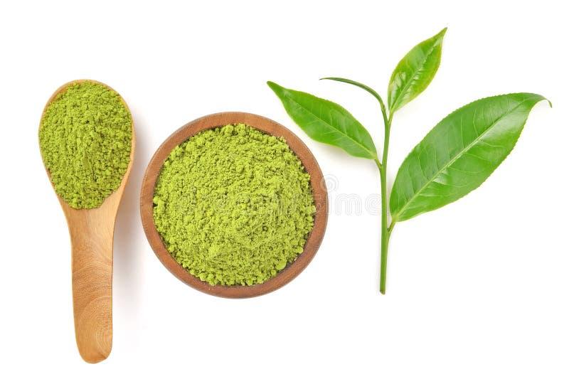 Vista superior del té verde del polvo y de la hoja de té del verde en pizca fotos de archivo