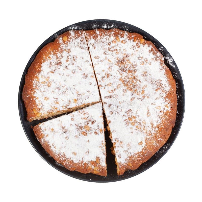 vista superior do bolo italiano do pinhão na placa preta imagem de stock