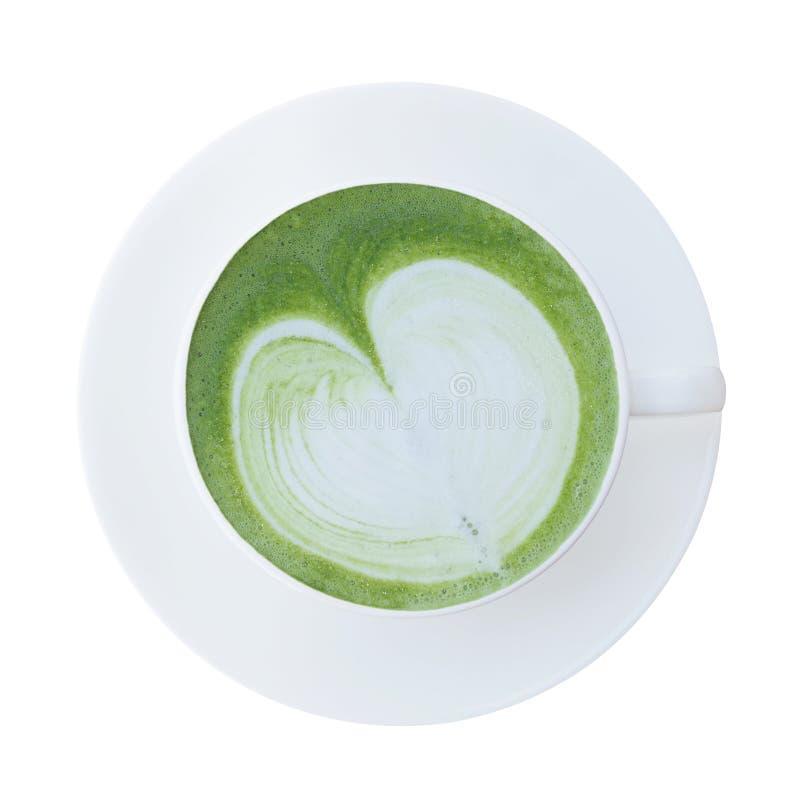 Vista superior do copo japonês do latte do chá verde do matcha com isolador dos pires imagens de stock