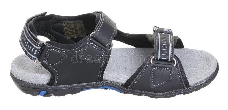 Vista superior lateral de la sandalia negra, azul y gris del muchacho foto de archivo libre de regalías
