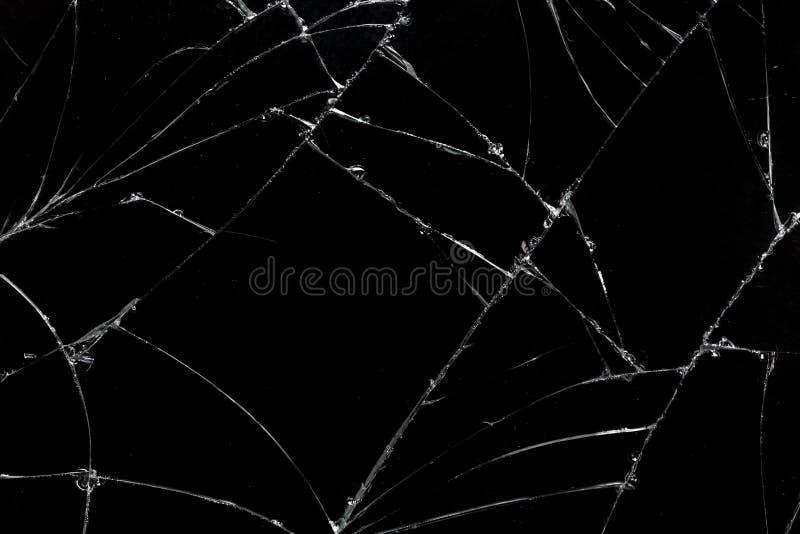 A vista superior rachou o fundo de vidro da textura da tela móvel quebrada foto de stock