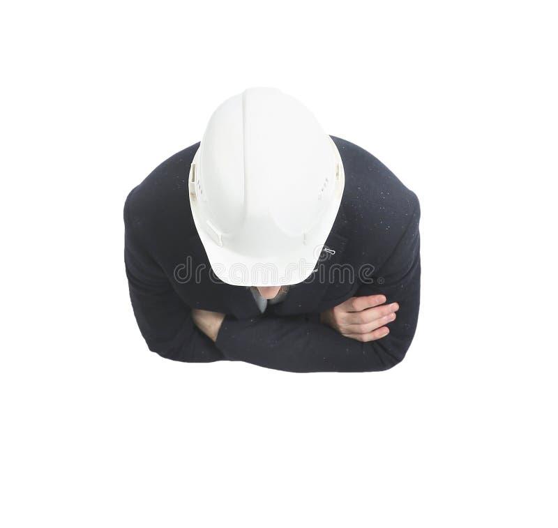 Vista superiore architetto dell'ingegnere in casco protettivo bianco fotografia stock