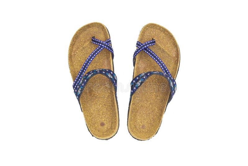 Vista superiore dei sandali femminili dei pantaloni a vita bassa isolati su fondo bianco, fine su, concetto di usura della scarpa immagine stock