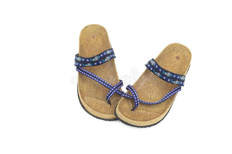 Vista superiore dei sandali femminili dei pantaloni a vita bassa isolati su fondo bianco, fine su, concetto di usura della scarpa immagini stock