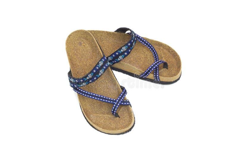 Vista superiore dei sandali femminili dei pantaloni a vita bassa isolati su fondo bianco, fine su, concetto di usura della scarpa fotografie stock