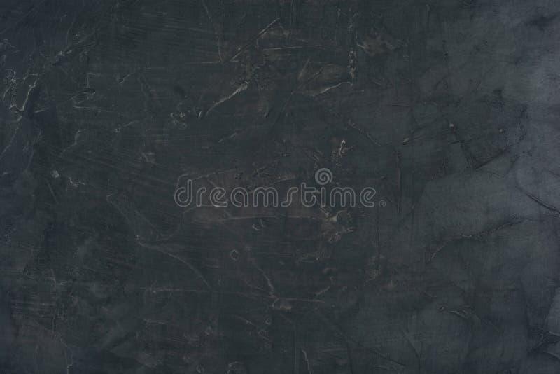 vista superiore del muro di cemento scuro grungy per fondo fotografia stock