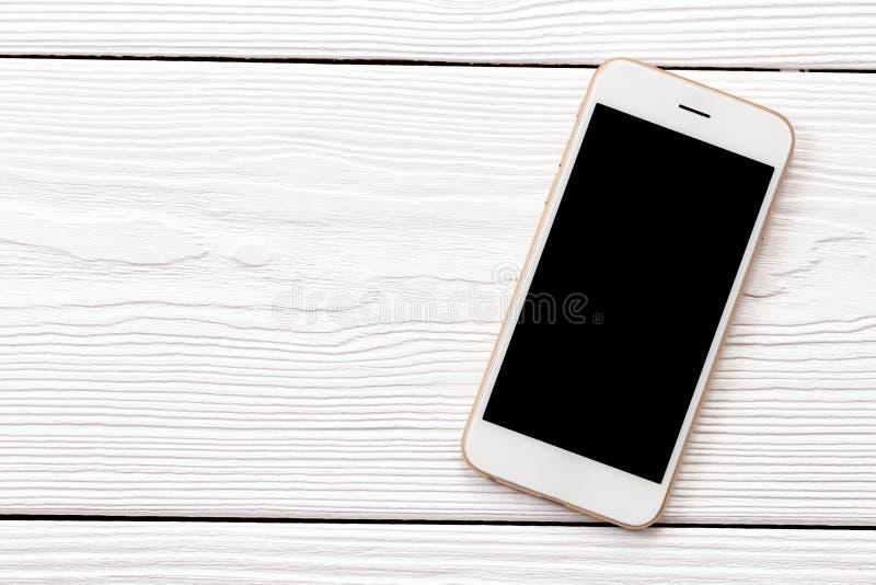 Vista superiore del telefono bianco immagine stock libera da diritti