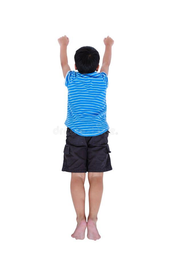 Vista superiore dell'assomigliare del bambino al supereroe di volo, isolata su bianco fotografie stock