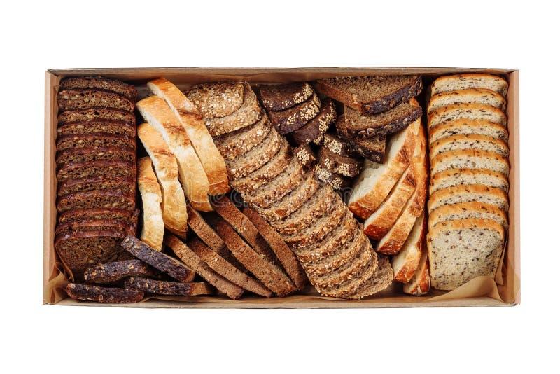 Vista superiore della scatola di consegna del cartone della miscela della fetta del pane fresco fotografia stock libera da diritti