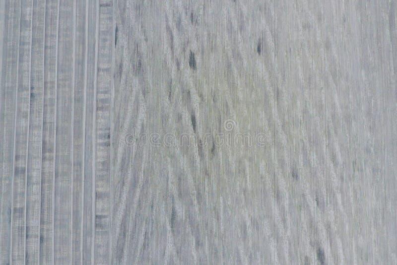 Vista superiore di un campo arato Struttura del fondo della superficie del campo arato Fucilazione con fotografia stock