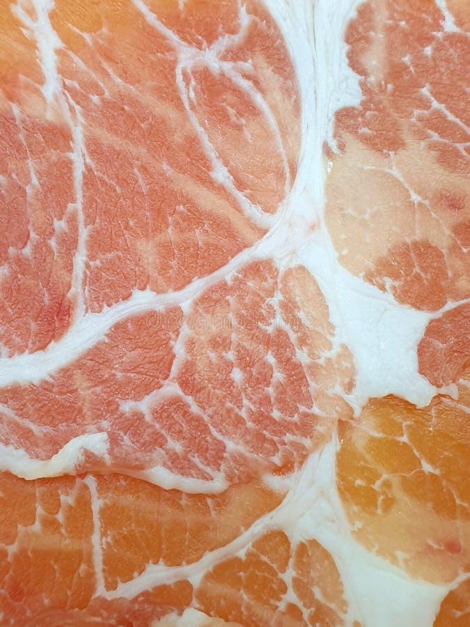 Vista superiore, fetta cruda della carne di maiale come fondo immagini stock libere da diritti