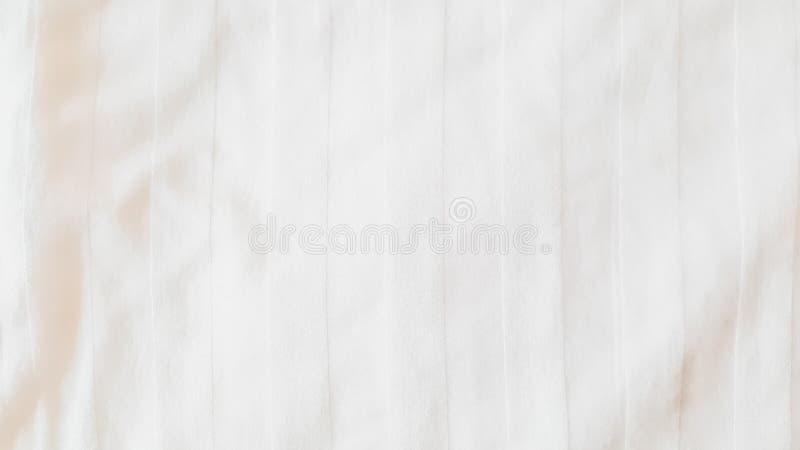 Vista superiore - strutture e modelli astratti del fondo del panno dello strato della lettiera con luce solare morbida nella came immagini stock
