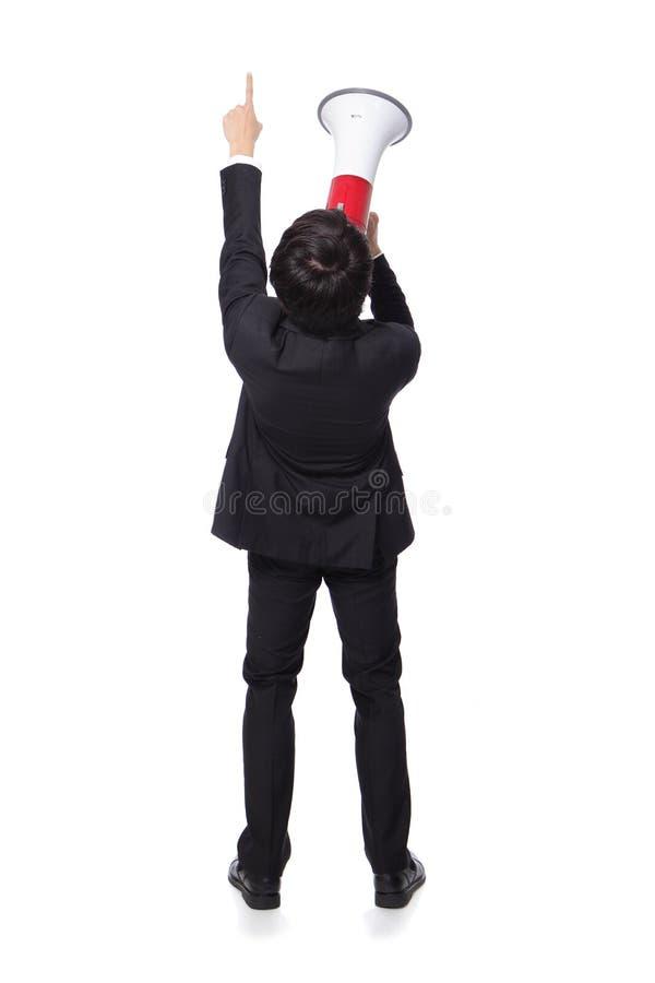 Vista traseira do megafone shouting do homem fotografia de stock royalty free