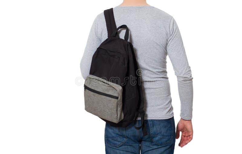 Vista traseira Homem novo que veste o t-shirt vazio e a trouxa longos da luva isolados no fundo branco Copie o espaço advert imagens de stock royalty free