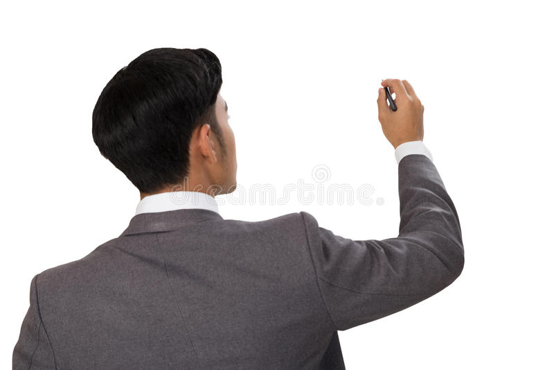 vista trasera de la escritura del hombre de negocios, dibujo en espacio en blanco imagenes de archivo