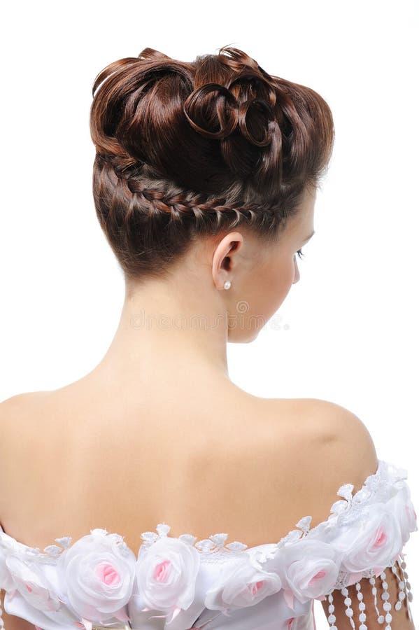 Vista trasera del peinado moderno de la boda fotografía de archivo