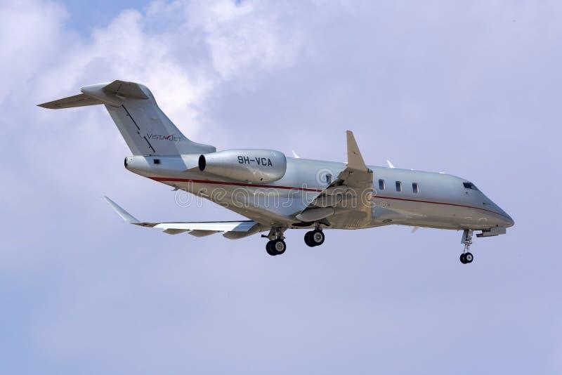 VistaJet-Geschäfts-Jet-Landung stockbild