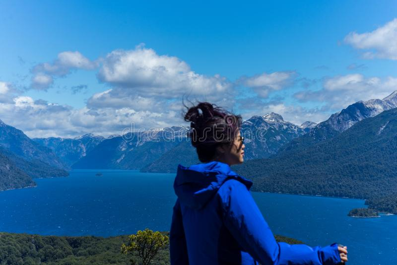 A woman tourist in the mountains and lakes of San Carlos de Bariloche, Argentina. Vistas of San Carlos de Bariloche, Argentina South America. Patagonia royalty free stock image