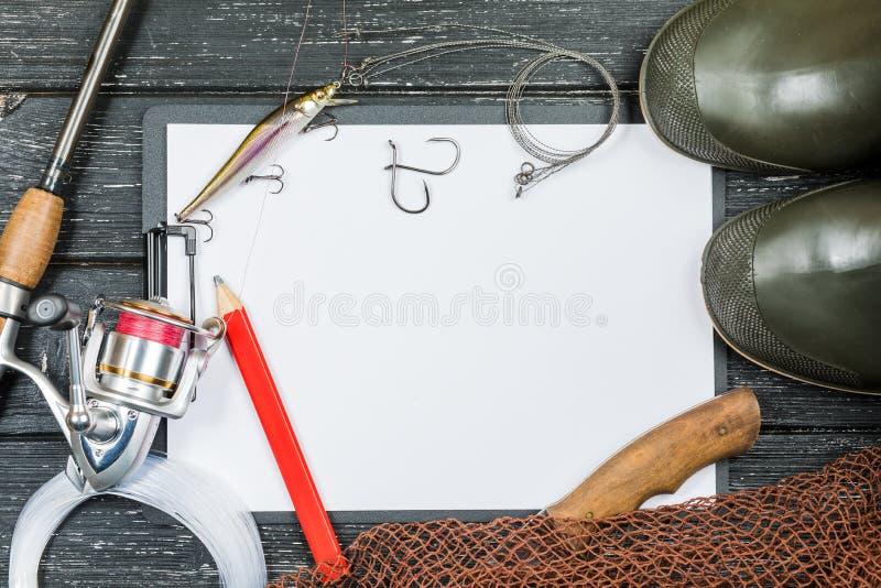 Vistuig - visserij, visserij, haken en aas, een oud blad o royalty-vrije stock foto